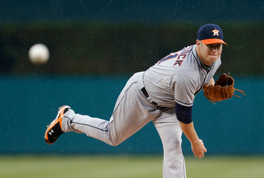 . Houston Astros pitcher Brad Peacock throws a warmup pitch against the Detroit Tigers in the first inning of a baseball game in Detroit Wednesday, May 7, 2014. (AP Photo/Paul Sancya)