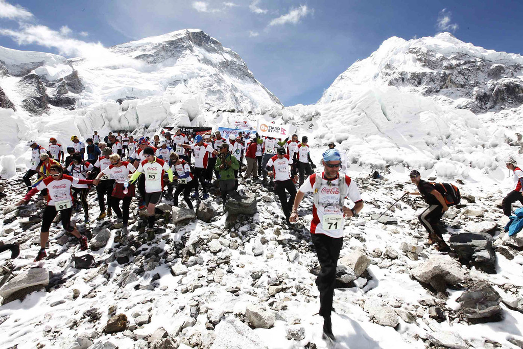 . In this handout photograph released by Himex, the organisers of the Tenzing-Hillary Everest Marathon on May 29, 2013, participatants of the marathon are flagged off at Everest Base Camp in Nepal\'s Solukhumbu district.   The Tenzing-Hillary Everest Marathon, the world�s highest marathon, starts near the famous Khumbu Ice Fall at Qomolangma Base Camp (5,364 meters above sea level) and finishes at Namche Bazar (3,440 meters above sea level).  Nepali athlete Ram Kumar Rajbhandari (31) clinched the title of the 11th Tenzing Hillary Everest Marathon, completing the 42.19 km race in 3 hour 59 minute 45 second on Wednesday as Nepali athletes continued their dominance in the highest altitude marathon claiming all top ten positions.      AFP/Getty/HIMEX-Tenzing-Hillary Everest Marathon