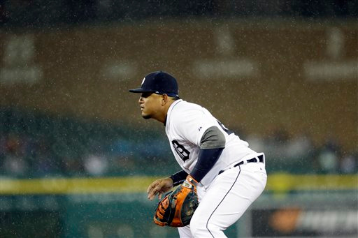 . Detroit Tigers first baseman Miguel Cabrera waits on the play in the rain during the seventh inning of a baseball game against the New York Yankees, Tuesday, April 21, 2015, in Detroit. (AP Photo/Carlos Osorio)