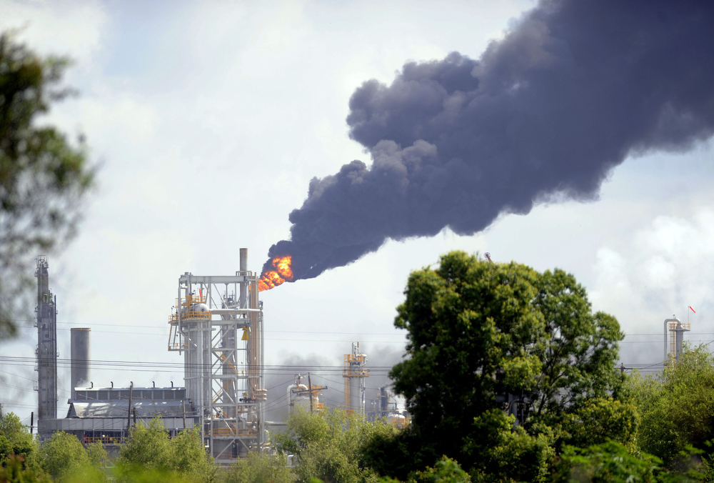 . Fire billows from athe Williams Olefins Plant  in Ascension Parish, La., on Thursday, June 13, 2013. Louisiana State Police are at the scene of the explosion and fire there are rreported several injuries as a result of the explosion. (AP Photo/The Baton Rouge Advocate, Catherine Threlkeld)