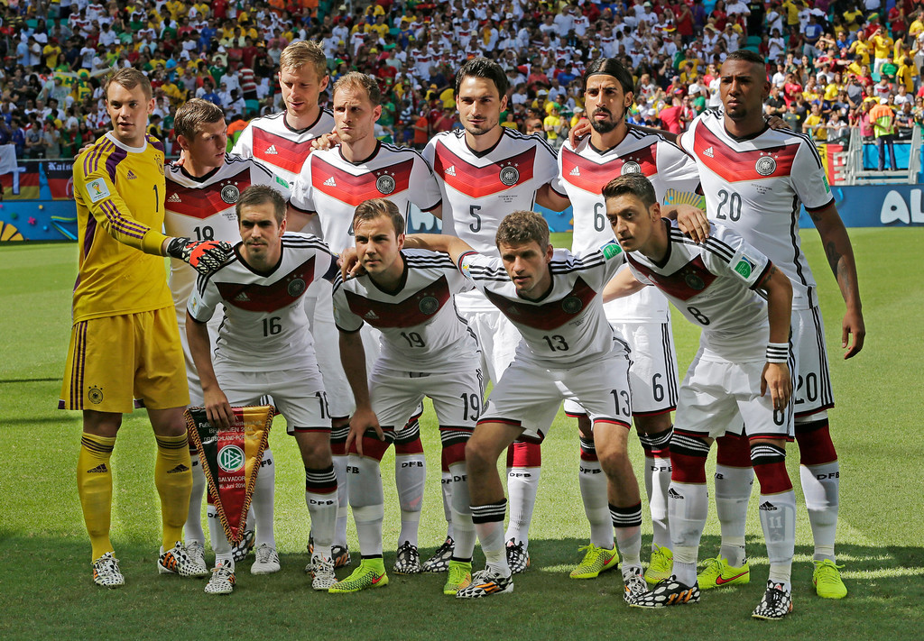 . The German team pose for a group photo ahead of the group G World Cup soccer match between Germany and Portugal at the Arena Fonte Nova in Salvador, Brazil, Monday, June 16, 2014.  (AP Photo/Matthias Schrader)
