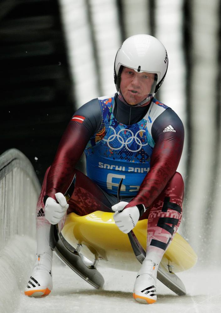 . Martins Ruebenis of Latvia finishes a run during the Luge Relay on Day 6 of the Sochi 2014 Winter Olympics at Sliding Center Sanki on February 13, 2014 in Sochi, Russia.  (Photo by Adam Pretty/Getty Images)