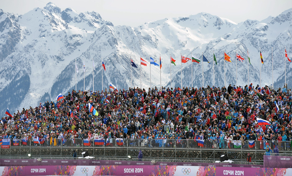 . Spectators watch the Men\'s 15km + 15km Skiathlon competition in the Laura Cross Country Center at the Sochi 2014 Olympic Games, Krasnaya Polyana, Russia, 09 February 2014.  EPA/HENDRIK SCHMIDT