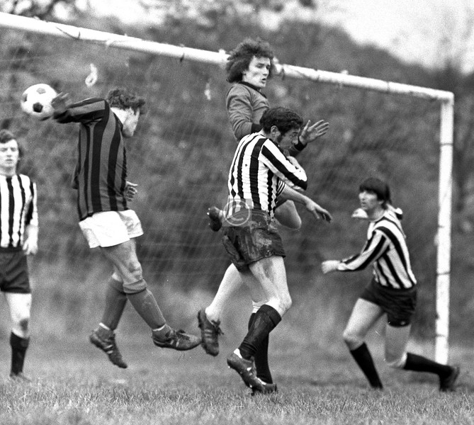 From the comparatively sublime to the totally cor blimey. I played at full-back (I was rubbish) for Park Mount AFC, the team in the black and white stripes, but was out with torn ankle ligaments so took a camera along to a home game at Carnwadric. With our 'keeper and centre-half at cross purposes, this looks like a goal, probably one of several, against us.   1974
