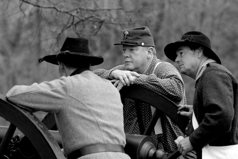 A few artillery reenactors relax just before the beginning of the reenactment. The Skirmish at Gamble's Hotel happened on March 5, 1885 when 500 federal soldiers, under the command of Reuben Williams of the 12th Indiana Infantry, marched into Florence to destroy the railroad depot but were met by Confederate soldiers backed up with 400 militia. The reenactment, held by the 23rd South Carolina Infantry, was held at the Rankin Plantation in Florence, South Carolina on Saturday, March 5, 2011. Photo Copyright 2011 Jason Barnette