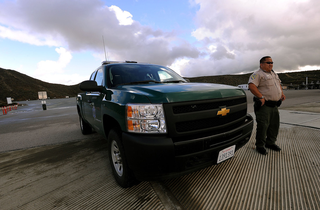. California Department of Fish and Wildlife Warden Kyle Chang patrols Diamond Valley Lake marina in Hemet March 8, 2013.  GABRIEL LUIS ACOSTA/STAFF PHOTOGRAPHER.