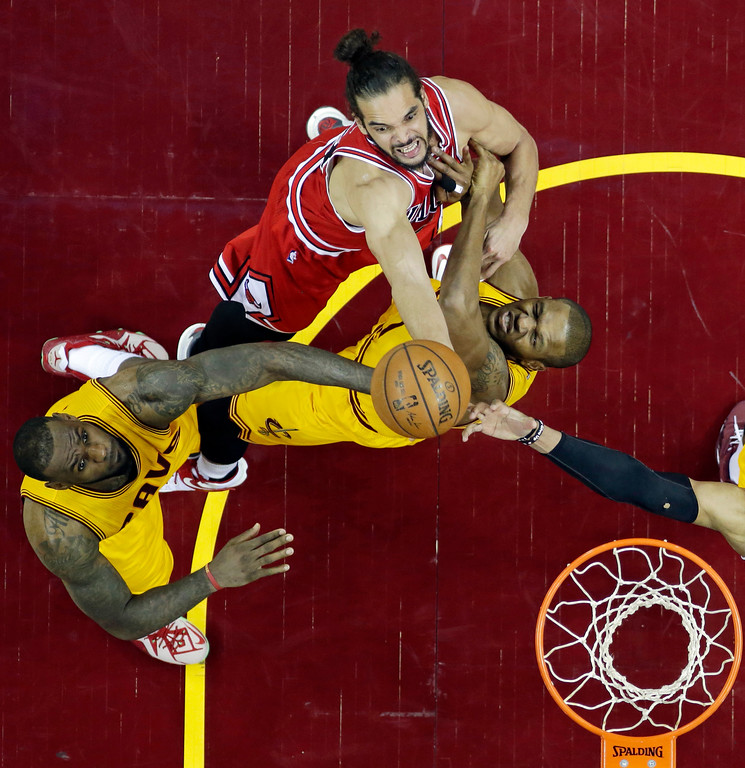 . Cleveland Cavaliers\' LeBron James, left and James Jones, right, try to block Chicago Bulls� Joakim Noah\'s shot during the second half of Game 5 in a second-round NBA basketball playoff series Tuesday, May 12, 2015, in Cleveland. The Cavaliers defeated the Bulls 106-101. (AP Photo/Tony Dejak)