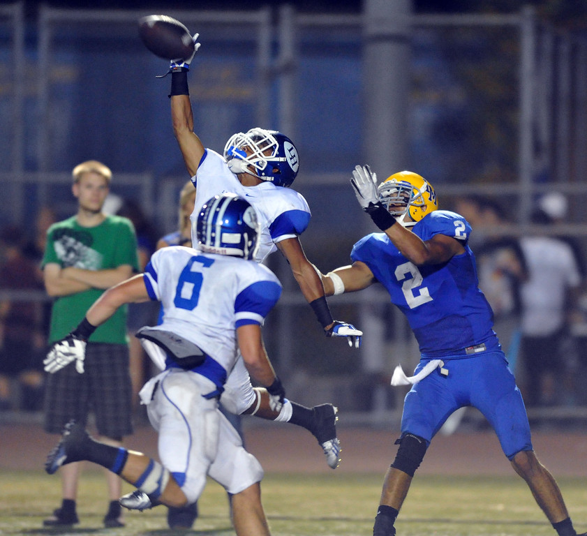 . La Habra\'s Elijah Carter (#2) deflects a pass intended for La Mirada\'s Dallis Todd (#2) in their football game at La mirada High School on Friday September 6, 2013. La Habra beat La Mirada 35-26. (Photo by Keith Durflinger/Whittier Daily News)