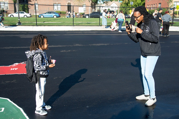 09/03/19 Wesley Bunnell | StaffrrOneil Teape ,age 6, poses for a photo taken by his big sister Amielie Teape before his fiirst day at Smalley School on Tuesday September 3, 2019. This is Oneil's first day of school in the U.S. after emigrating from Ethiopia with his family.