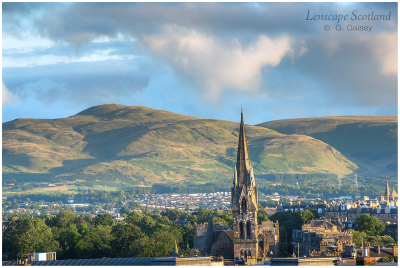 Pentland Hills and the spire of Barclay Viewforth Church from Edinburgh Castle esplanade