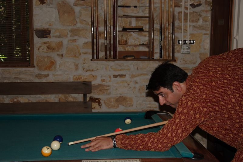 Anshul playing pool with friends before his wedding ceremony