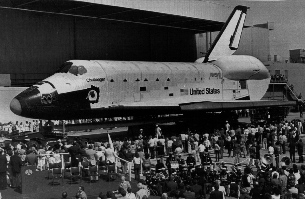 """. The Space Shuttle Challenger sits in front of the hanger at the Rockwell International Facility on June 40, 1982 at \""""turnover\"""" ceremonies when the manufacturer, Rockwell, turned the then new vehicle over to NASA. The Shuttle was destroyed 1/28/86 in an apparent explosion shortly after launch.  Denver Post Library Archive"""