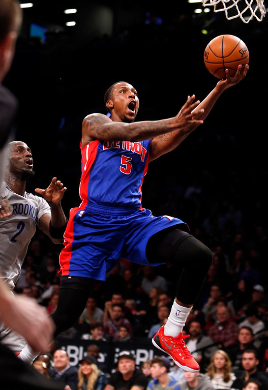 . Detroit Pistons\' Kentavious Caldwell-Pope (5) goes to the basket past Brooklyn Nets\' Kevin Garnett, left, during the second quarter of an NBA basketball game Sunday, Dec. 21, 2014, in New York. (AP Photo/Jason DeCrow)