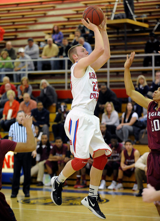 . GREENWOOD VILLAGE, CO. - FEBRUARY 13: Cherry Creek\'s Will Bower pulls up for a jump shot in the first half Wednesday night at Cherry Creek High School. (Photo by Steve Nehf, The Denver Post)
