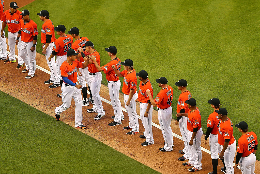 . Giancarlo Stanton #27 of the Miami Marlins is greeted by teammates during Opening Day against the Colorado Rockies at Marlins Park on March 31, 2014 in Miami, Florida.  (Photo by Mike Ehrmann/Getty Images)
