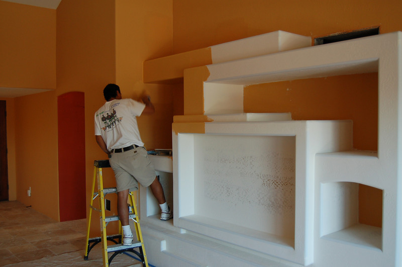 And inside, paint is being applied to make the entertainment center blend into the rest of the room.