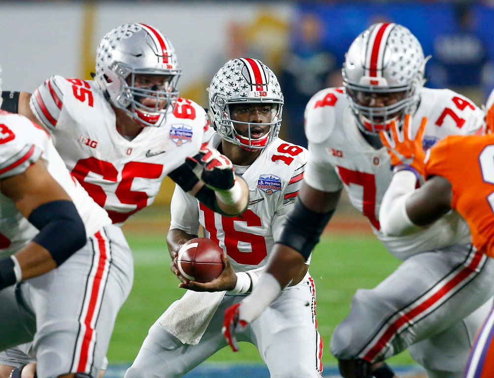 . Ohio State quarterback J.T. Barrett (16) takes the snap against Clemson during the first half of the Fiesta Bowl NCAA college football game, Saturday, Dec. 31, 2016, in Glendale, Ariz. (AP Photo/Ross D. Franklin)