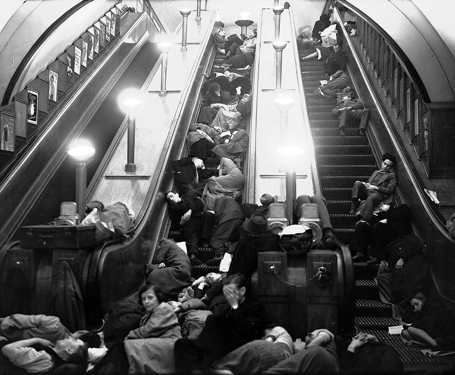 . Londoners sleep on stationary escalators in a London Underground station during Nazi bombing raids on Sept. 27, 1940. (AP Photo)