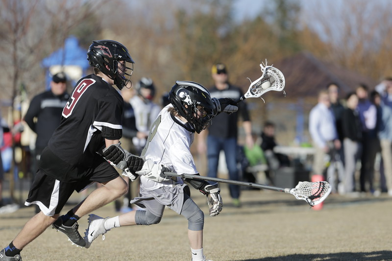 JPM0279-JPM0279-Jonathan first HS lacrosse game March 9th.jpg