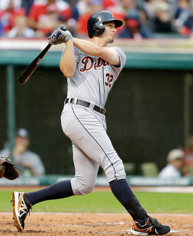 . Detroit Tigers\' Don Kelly hits a double off Cleveland Indians starting pitcher Corey Kluber in the third inning of a baseball game, Friday, June 20, 2014, in Cleveland. (AP Photo/Tony Dejak)