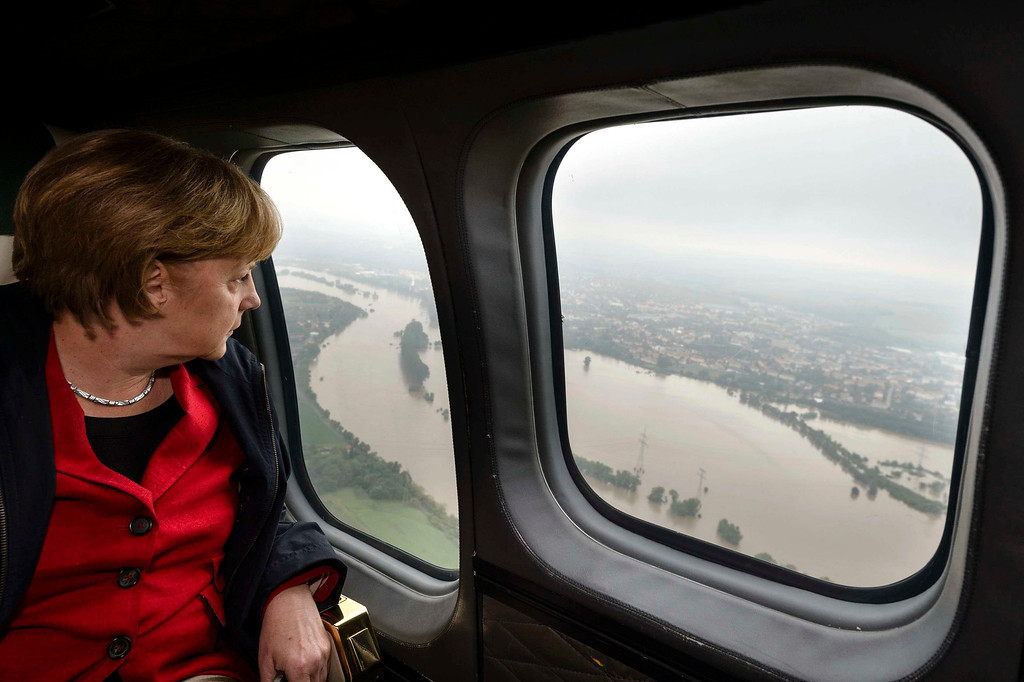 . German Chancellor Angela Merkel looks down at flood damage from a helicopter during a flight between Dresden and Pirna June 4, 2013, in this picture provided by BPA.  REUTERS/Steffen Kugler/BPA via Reuters