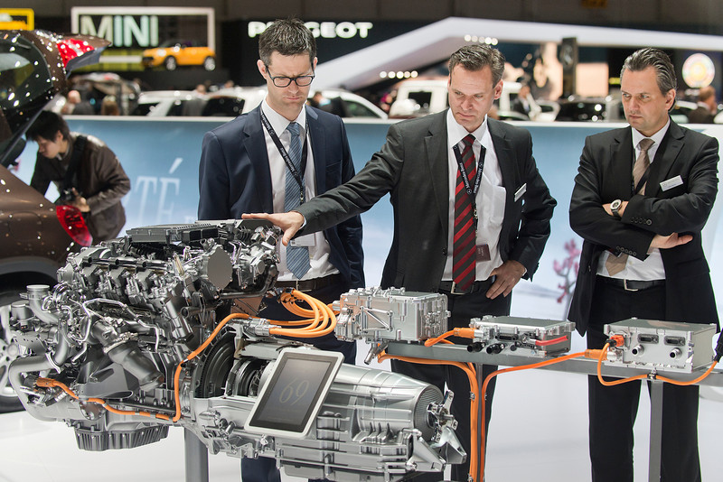 . Journalists take a look at a Mercedes engine during the press day at the 84th Geneva International Motor Show in Geneva, Switzerland, Wednesday, March 5, 2014. (AP Photo/Keystone, Sandro Campardo)