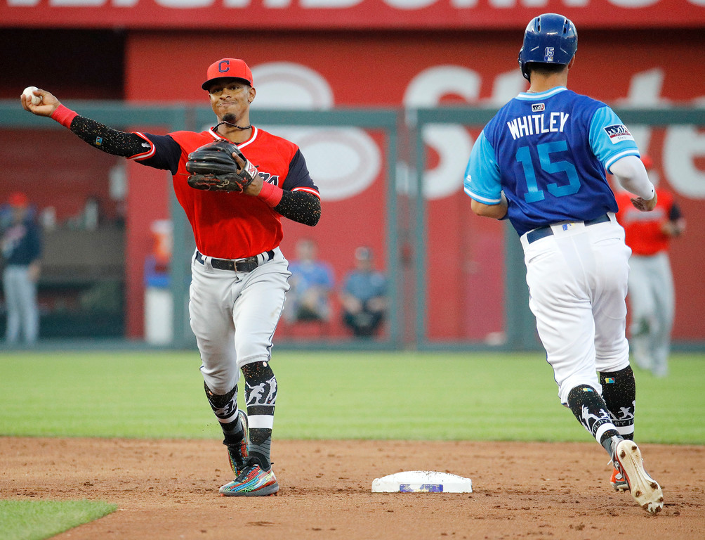 . Cleveland Indians shortstop Francisco Lindor throws to first for the double play hit into by Kansas City Royals\' Alex Gordon, after after forcing out Whit Merrifield (15) at second during the third inning of a baseball game Saturday, Aug. 25, 2018, in Kansas City, Mo. (AP Photo/Charlie Riedel)