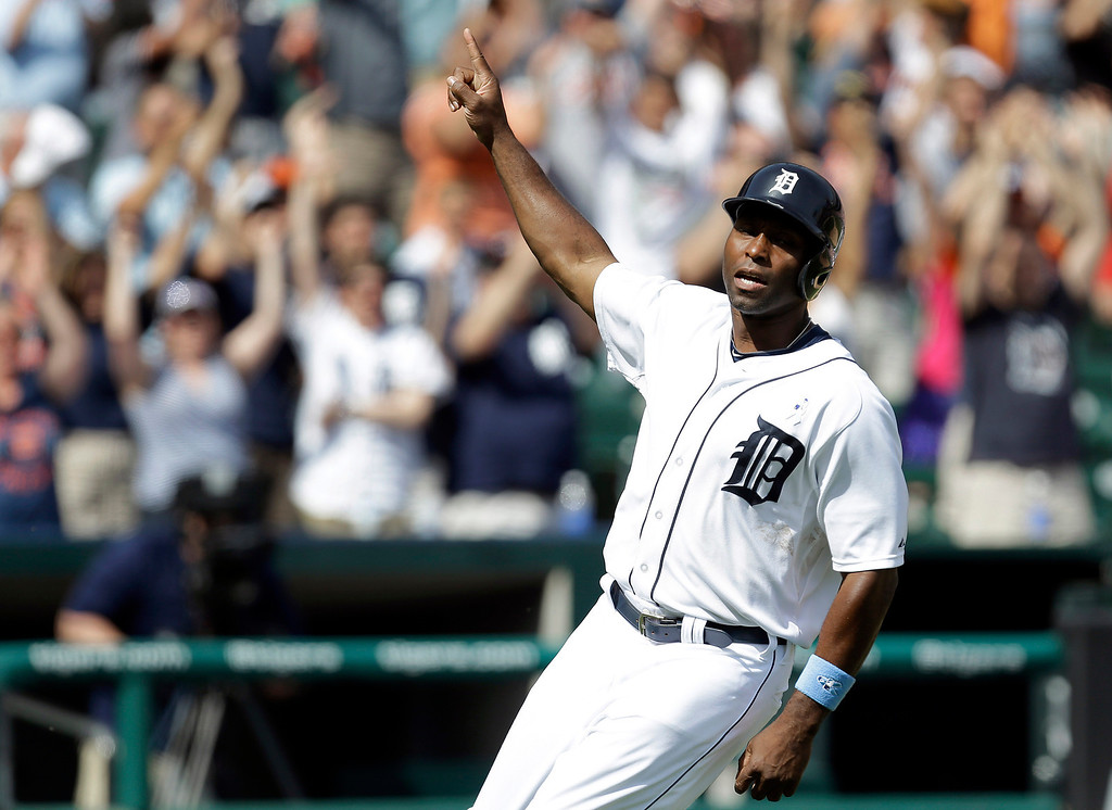 . Detroit Tigers\' Torii Hunter celebrates after scoring on a J.D. Martinez walkoff sacrifice fly against the Minnesota Twins in the ninth inning of a baseball game in Detroit, Sunday, June 15, 2014. Detroit won 4-3. (AP Photo/Paul Sancya)