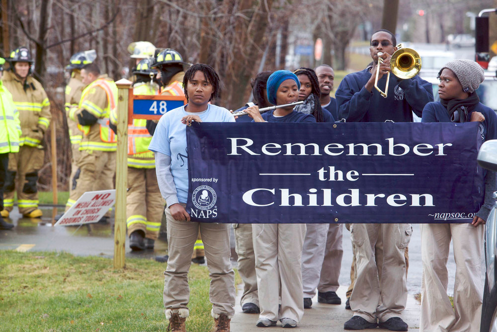 . Members of the National Association for the Prevention of Starvation play music outside the funeral mass for Rachel Marie D\'Avino at the Church of the Nativity in Bethlehem, Connecticut, December 21, 2012. D\'Avino was a victim of the December 14 shootings at Sandy Hook Elementary School in Newtown, Connecticut. REUTERS/Michelle McLoughlin