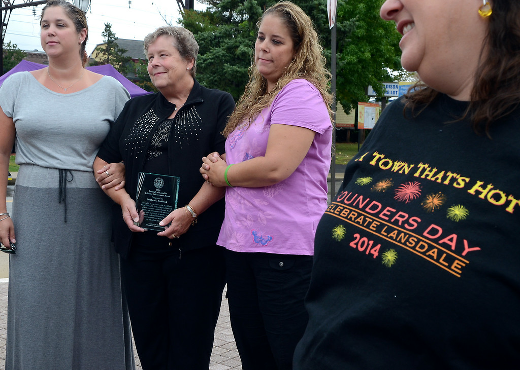 . The Lansdale Borough Lifetime Achievement Award is presented to the family of Stephen Frederick ,his wife Dorothy ,center, and daughters Stephanie ,L, and Karen Diehl by Mary Fuller during the Lansdale Founders Day celebration and on Saturday August 23,2014. Photo by Mark C Psoras/The Reporter