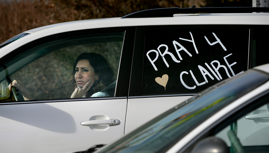 . A woman has a message written on her car outside Arapahoe High School in Centennial, CO December 19, 2013. Seniors and Juniors will return to the school for two hour periods Thursday, Sophomores and Freshmen will return on Friday. The victim from Friday�s shooting at Arapahoe High School, Claire Davis, 17, remains in critical condition. She was shot on Friday when classmate Karl Pierson opened fire in the school. The gunman died from a self-inflicted gunshot wound. (Photo By Craig F. Walker / The Denver Post)