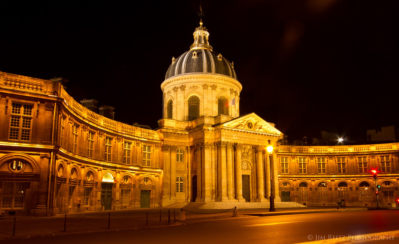 Institute des France- nighttime view from along the Seine river.