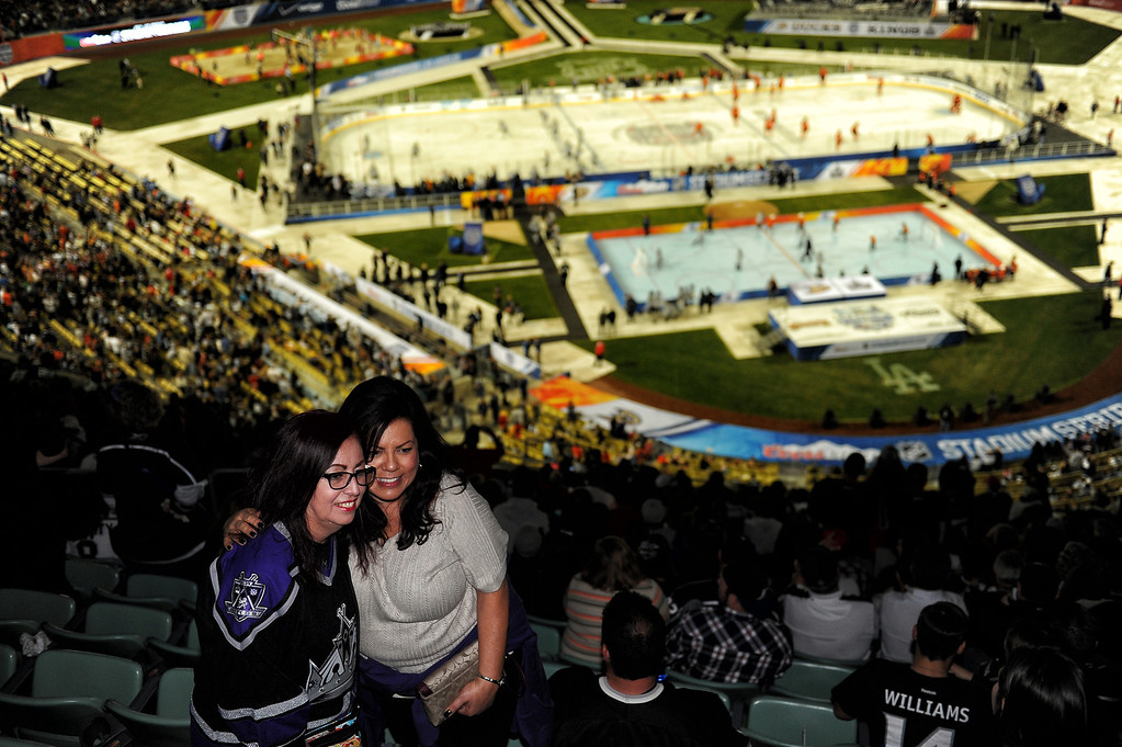 . Fans watch the 2014 NHL Stadium Series featuring the Los Angeles Kings taking on the Anaheim Ducks at Dodger Stadium January 25, 2014. (Photo by Hans Gutknecht/Los Angeles Daily News)