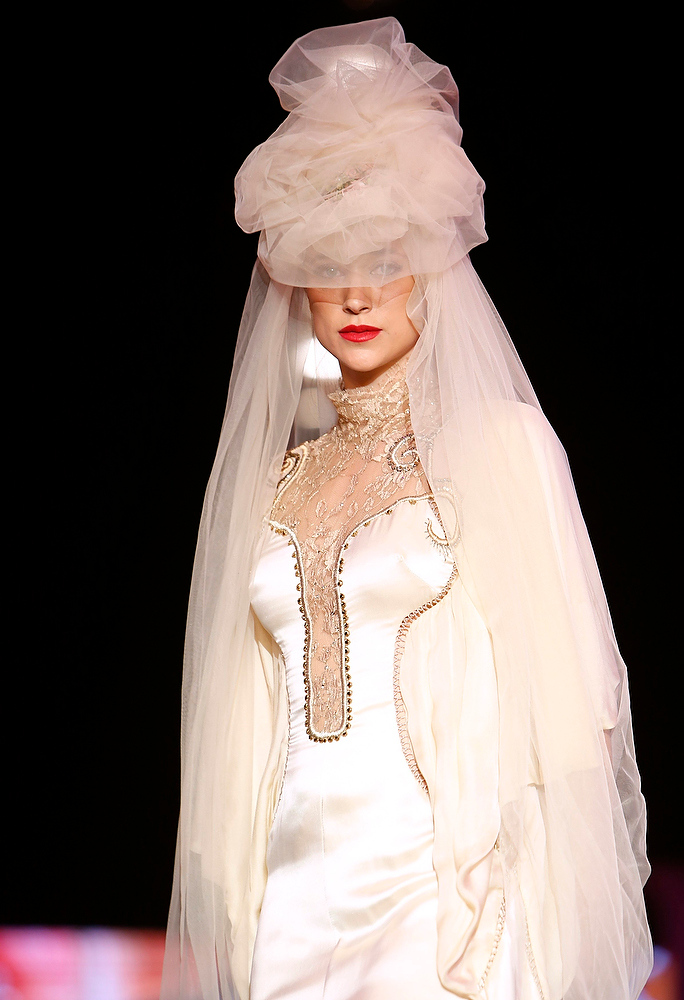 . A model presents a creation by a fashion student from the Shenkar College of Engineering and Design during Fashion Week in Tel Aviv December 18, 2012. The show featured wedding gowns inspired by models of synagogues that are on display at Beit Hatfutsot Museum in Tel Aviv. REUTERS/Amir Cohen