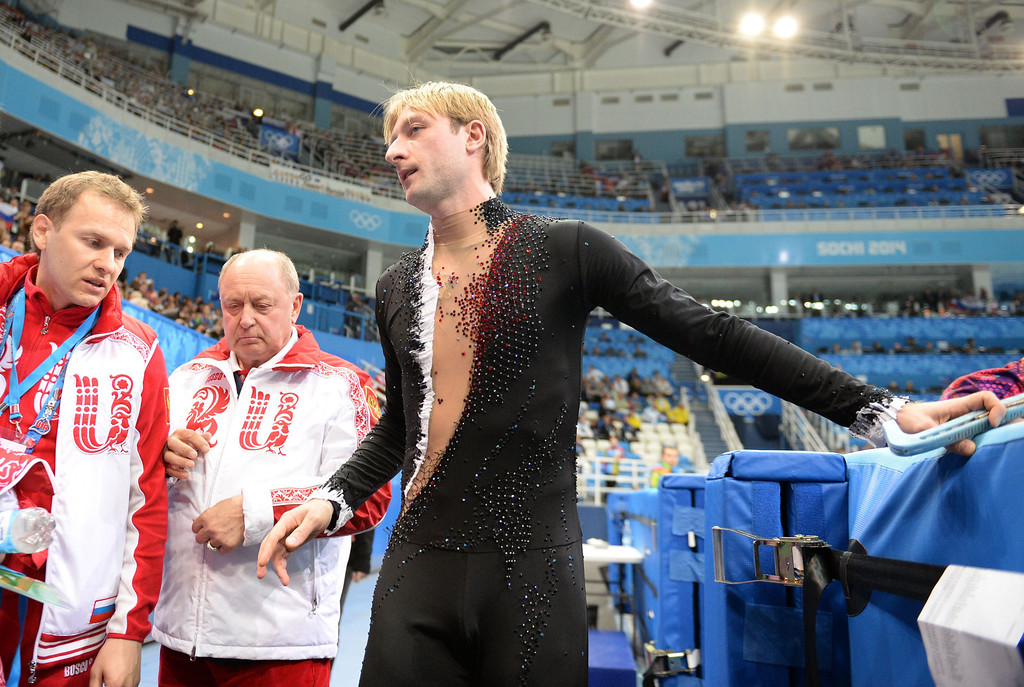 . Russia\'s Yevgeny Plushenko leaves the ice after withdrawing from the Men\'s Figure Skating Short Program at the Iceberg Skating Palace during the Sochi Winter Olympics on February 13, 2014. Two-time Olympic gold medalist Yvegeny Plushenko withdrew from the Sochi Olympics injured before competing in the men\'s figure skating short program today.  YURI KADOBNOV/AFP/Getty Images