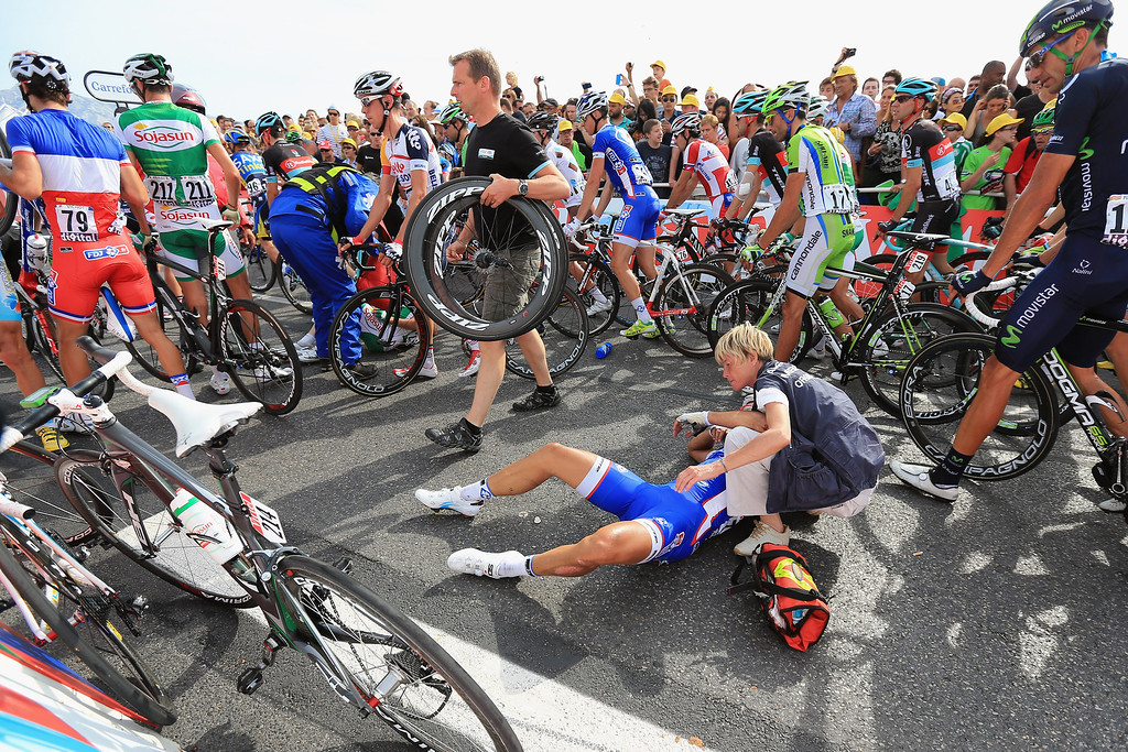 . Nacer Bouhanni of France riding for Francaise des Jeux is attended to by medical personnel after being involved in a crash in the last kilometer of stage five of the 2013 Tour de France, a 228.5KM road stage from Cagnes-sur-mer to Marseille, on July 3, 2013 in Marseille, France.  (Photo by Doug Pensinger/Getty Images)