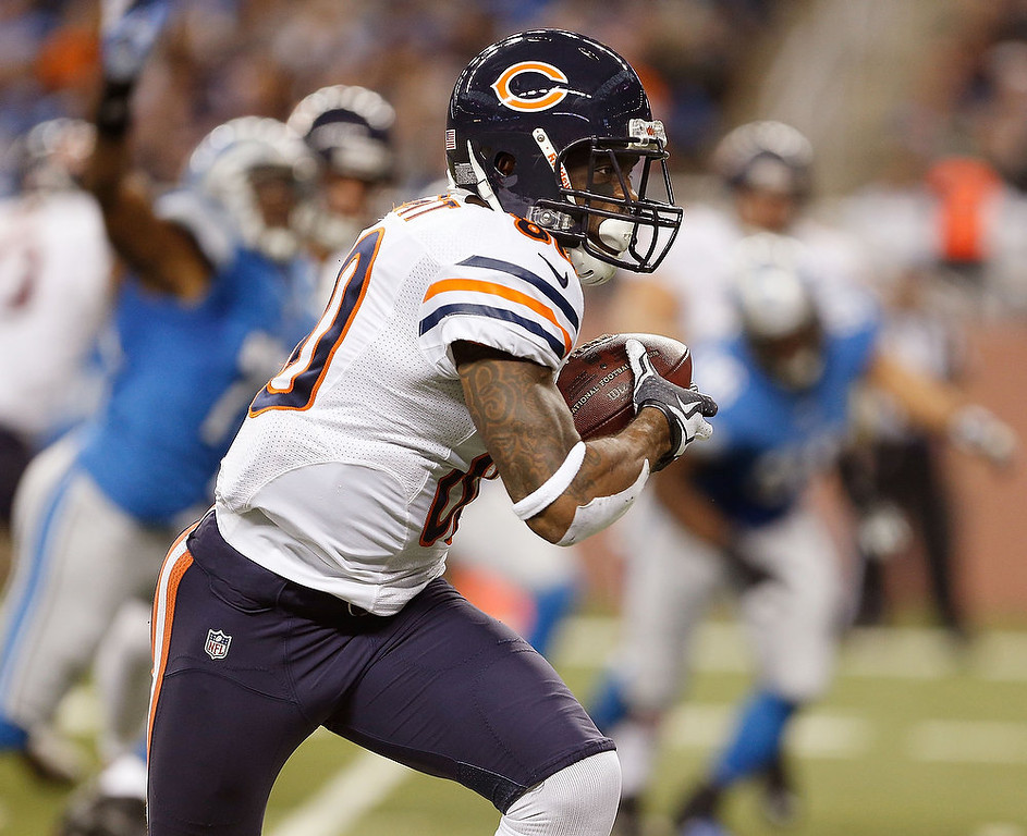 . Earl Bennett #80 of the Chicago Bears looks for running room after a third quarter catch while playing the Detroit Lions at Ford Field on December 30, 2012 in Detroit, Michigan. Chicago won the game 26-24. (Photo by Gregory Shamus/Getty Images)