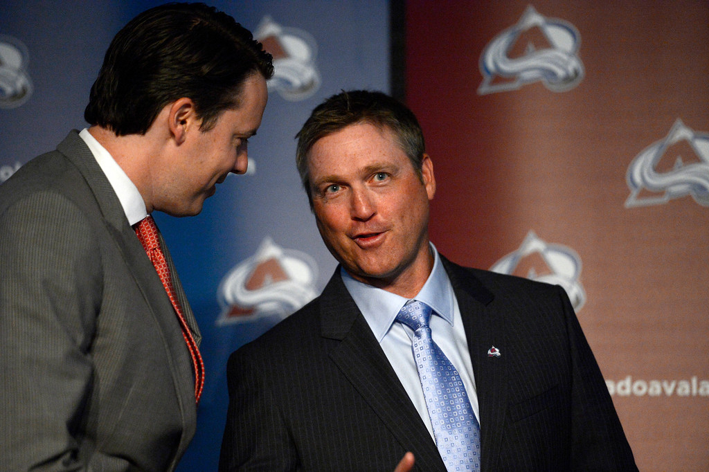 . Patrick Roy, Head Coach/Vice President of Hockey Operations talks with Avalanche President Josh Kroenke after their press conference. The Colorado Avalanche introduced Roy as their new head coach/vice president of hockey operations May 28, 2013 at Pepsi Center. Roy is now the sixth  head coach in Avalanche history since the team came to Denver. (Photo By John Leyba/The Denver Post)