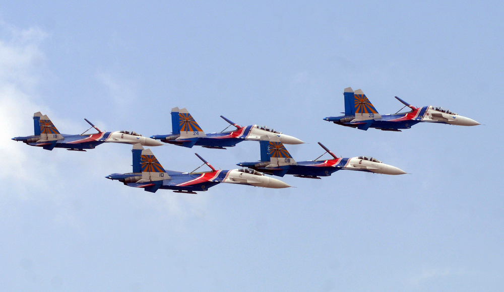 . The Russian Airforce aerobatic display team, Russian Knights arrive in formation in their Sukhoi Su-27s on the third day of the 9th edition of the Aero India 2013 at Yelahanka Air Force station in Bangalore on February 8, 2013.    India, the world\'s leading importer of weaponry, opened one of Asia\'s biggest aviation trade shows February 6 with Western suppliers eyeing lucrative deals and a Chinese delegation attending for the first time.  AFP/Manjunath KIRANManjunath Kiran/AFP/Getty Images