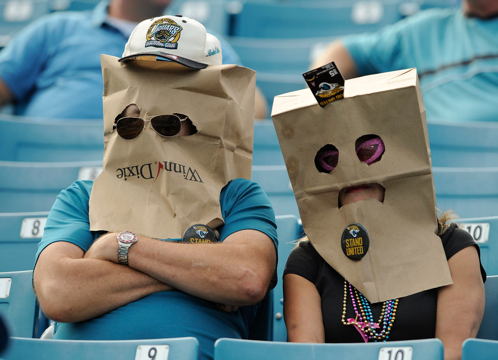 . Disappointed Jacksonville Jaguars fans wear bags on their heads as they watch their team lose to the San Diego Chargers 24-6 in an NFL football game in Jacksonville, Fla., Sunday, Oct. 20, 2013. (AP Photo/Stephen Morton)