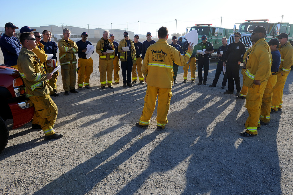 . Pasadena and Burbank firefighters hold a meeting at the command center in Freedom Park in Camarillo before going to the Springs Fire, Friday, May 3, 2013. (Michael Owen Baker/Los Angeles Daily News)
