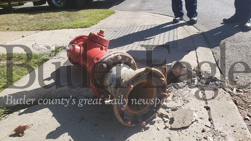 While responding to a call for downed wires at about 10:40 a.m. Wednesday, Butler Bureau of Fire firefighters spotted this fire hydrant lying in the street at the corner of McKean and Penn streets in Butler.Further information on whatever hit-and-run caused the hydrant damage was not available. Photo by Tanner Cole
