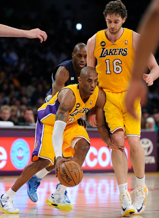 . The Lakers\' Kobe Bryant dribbles into Pau Gasol against the Grizzlies, Friday, April 5, 2013, at Staples Center. (Michael Owen Baker/Los Angeles Daily News)