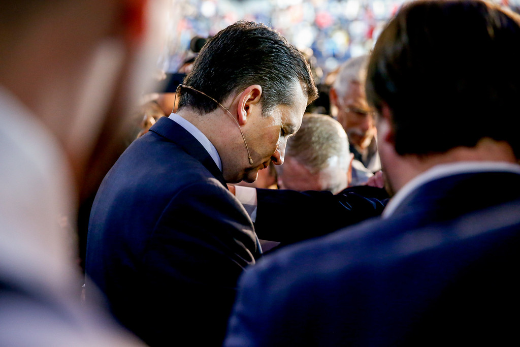 . Sen. Ted Cruz, R-Texas prays with members of the audience after announcing his campaign for president, Monday, March 23, 2015,  at Liberty University, founded by the late Rev. Jerry Falwell, in Lynchburg, Va. Cruz, who announced his candidacy on twitter in the early morning hours, is the first major candidate in the 2016 race for president. (AP Photo/Andrew Harnik)