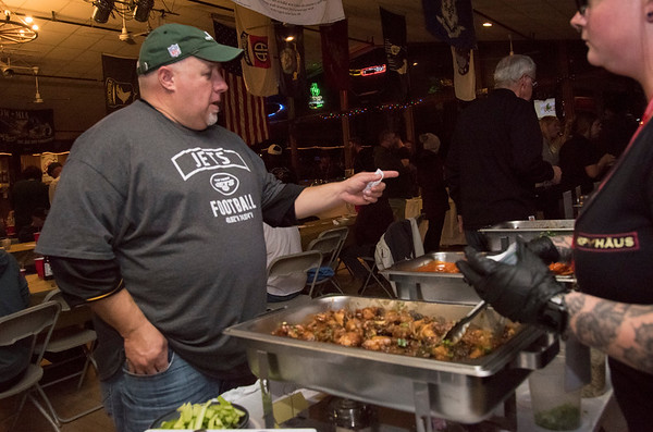 11/19/19 Wesley Bunnell | StaffrrMatt Eisele chooses which wings to sample at the Hop Haus table during the Southington Chamber of Commerce's annual WingFest at the Cadillac Ranch on Monday night November 18 , 2019.