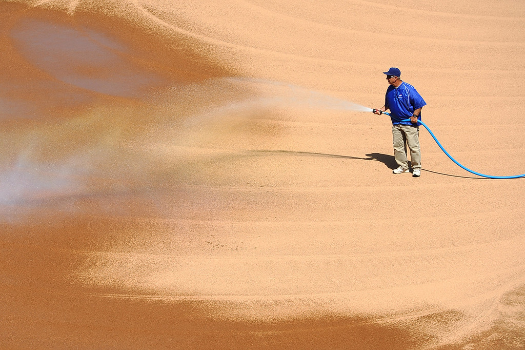 . Dodger Stadium head grounds keeper Eric Hansen prepares the field for the Opening Weekend series with the Giants Thursday April 3, 2014.(Andy Holzman/Los Angeles Daily News)