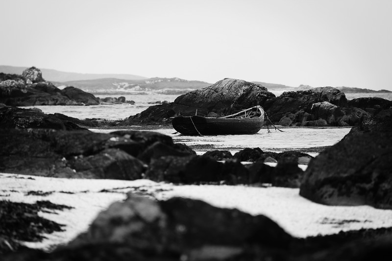 Wooden Boat Among the Rocks