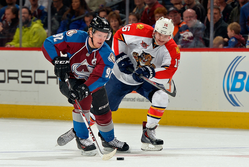 . Colorado Avalanche left wing Gabriel Landeskog (92), from Sweden, moves the puck against Florida Panthers center Aleksander Barkov (16), from Finland, during the first period of an NHL hockey game on2 Saturday, Nov. 16, 2013, in Denver. (AP Photo/Jack Dempsey)