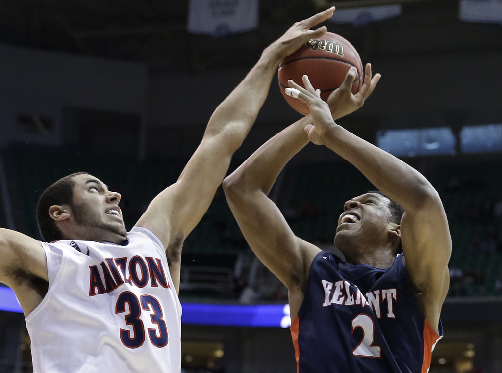 . Arizona\'s Grant Jerrett (33) blocks a shot by Belmont\'s Blake Jenkins (2) during the first half in a second-round game in the NCAA college basketball tournament in Salt Lake City Thursday, March 21, 2013. (AP Photo/Rick Bowmer)