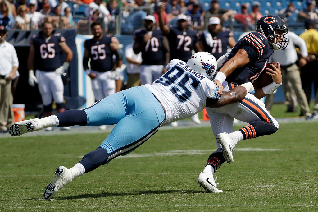 . Tennessee Titans defensive end Angelo Blackson (95) brings downs Chicago Bears quarterback Mitchell Trubisky in the second half of an NFL football preseason game Sunday, Aug. 27, 2017, in Nashville, Tenn. The Bears won 19-7. (AP Photo/James Kenney)